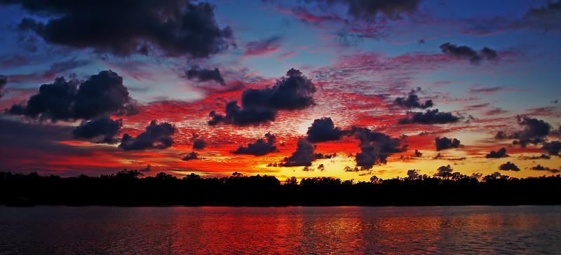 Crimson and Charcoal dramatic ocean sunrise seascape.