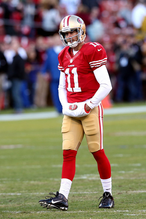 . Quarterback Alex Smith #11 of the San Francisco 49ers looks on during warm ups prior to the NFC Divisional Playoff Game against the Green Bay Packers at Candlestick Park on January 12, 2013 in San Francisco, California.  (Photo by Stephen Dunn/Getty Images)