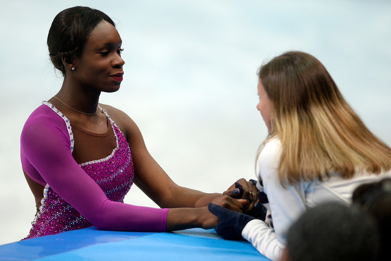 . France\'s Mae Berenice Meite receives last-minute encouragement before scoring a 55.45 in ladies short program during team figure skating. Sochi 2014 Winter Olympics on Saturday, February 8, 2014. (Photo by AAron Ontiveroz/The Denver Post)