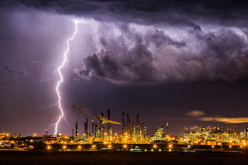 I was filming behind the barbed wire at Africa's biggest industrial complex. A powerful storm quickly approached, and lightning struck around me, I had to pack up and run.  #Lightning #Weather #Refinery #SouthAfrica #Alien #City #Storm