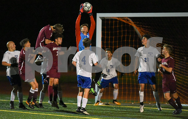 10/30/17 Wesley Bunnell | Staff Bristol Central @ Bristol Eastern on Monday evening at Bristol Eastern High School. Bristol Easterns Tom Tefoe #1 leaps for the ball.