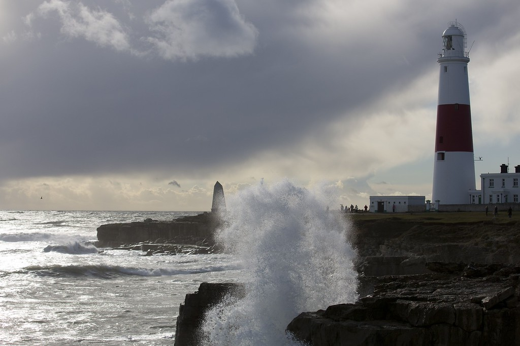 . Waves crash into the rocks in front for the lighthouse in Portland Bill in Dorest, southern England on October 28, 2013 following a strong storm. AFP PHOTO / JUSTIN TALLIS/AFP/Getty Images