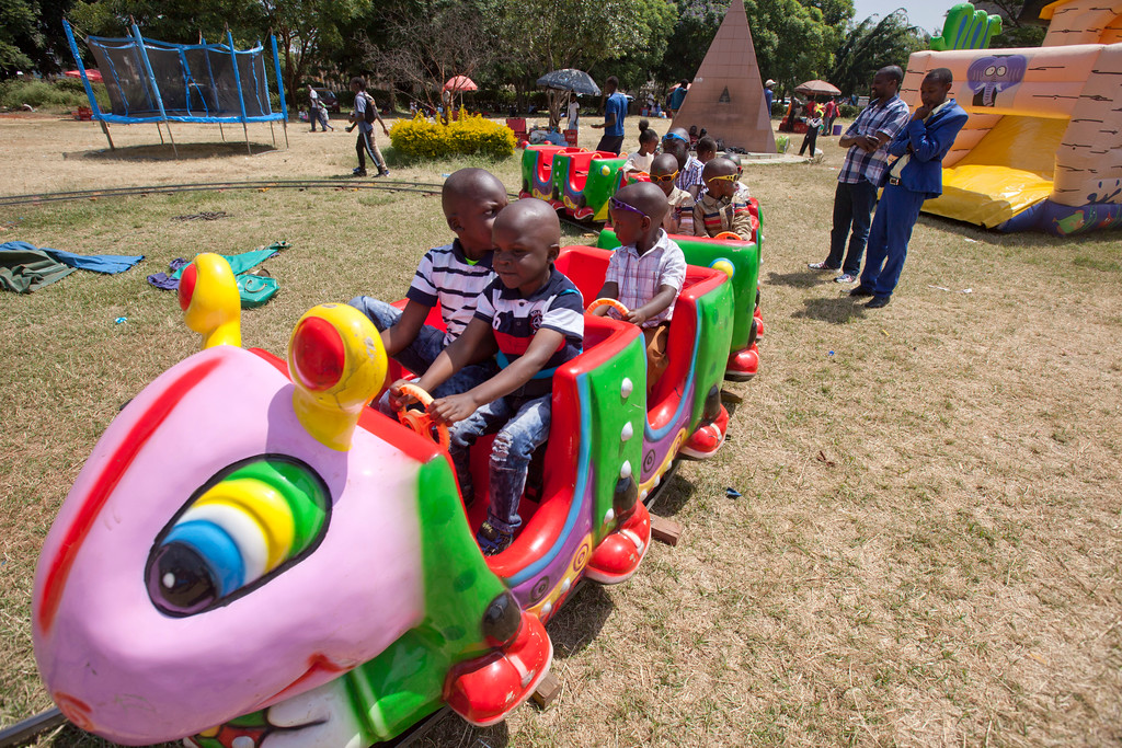 . Children take a train ride during New Year\'s celebrations at Uhuru Park in Nairobi, Kenya, Monday, Jan. 1, 2018. Hundreds of Kenyans gathered with their children to celebrate at the park. (AP Photo/Sayyid Abdul Azim)