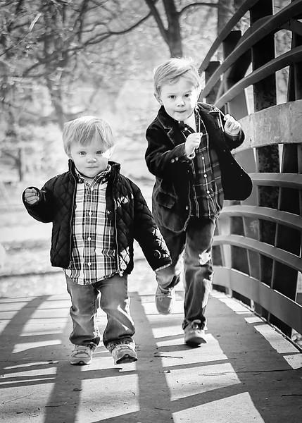 Brothers Run on Bridge crop bw (1 of 1).jpg