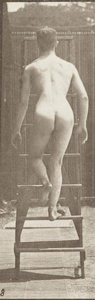 Nude man ascending a stepladder
