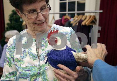 barn-yarn-retirees-knitting-sweaters-for-chilly-chickens