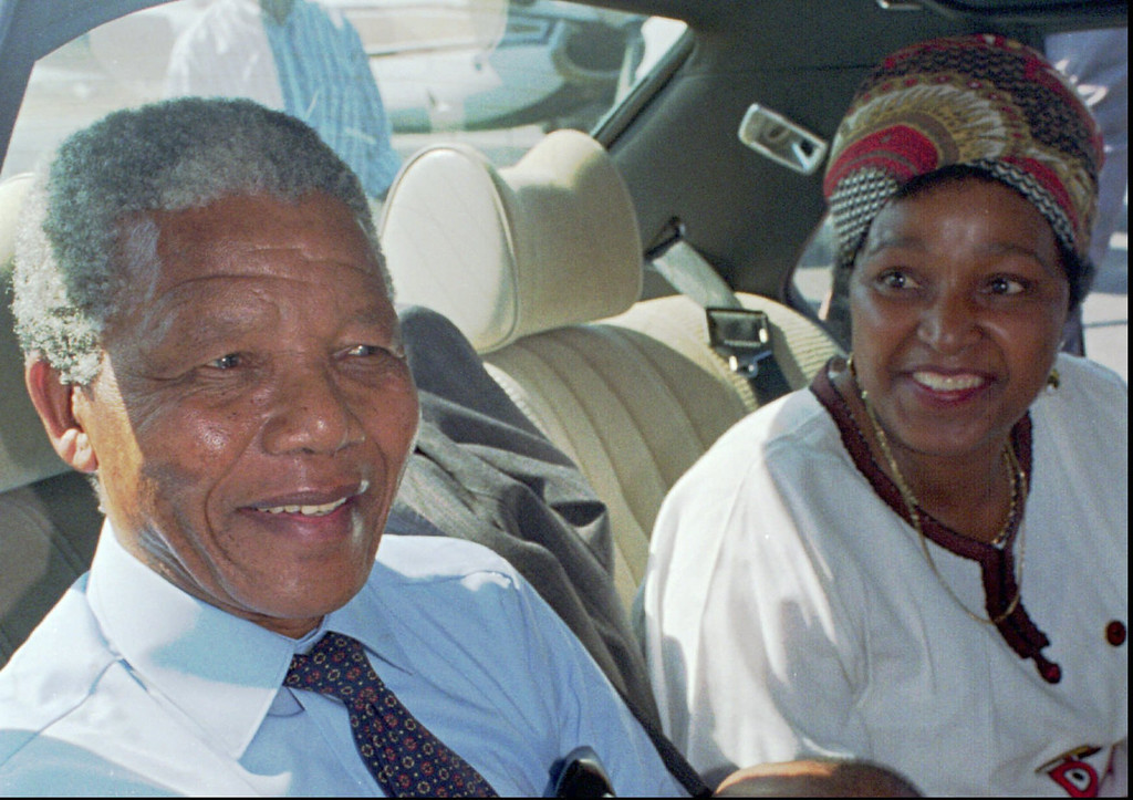 . Nelson Mandela, left, and his wife Winnie, right, at Cape Town\'s airport prior to a flight to Johannesburg in this February 1990 photo, the day after his release from prison.(AP Photo /File, Adil Bradlow)