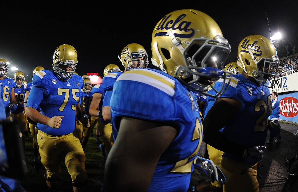 . UCLA enters field prior to their college football game against California in the Rose Bowl in Pasadena, Calif., on Saturday, Oct. 12, 2013.   (Keith Birmingham Pasadena Star-News)