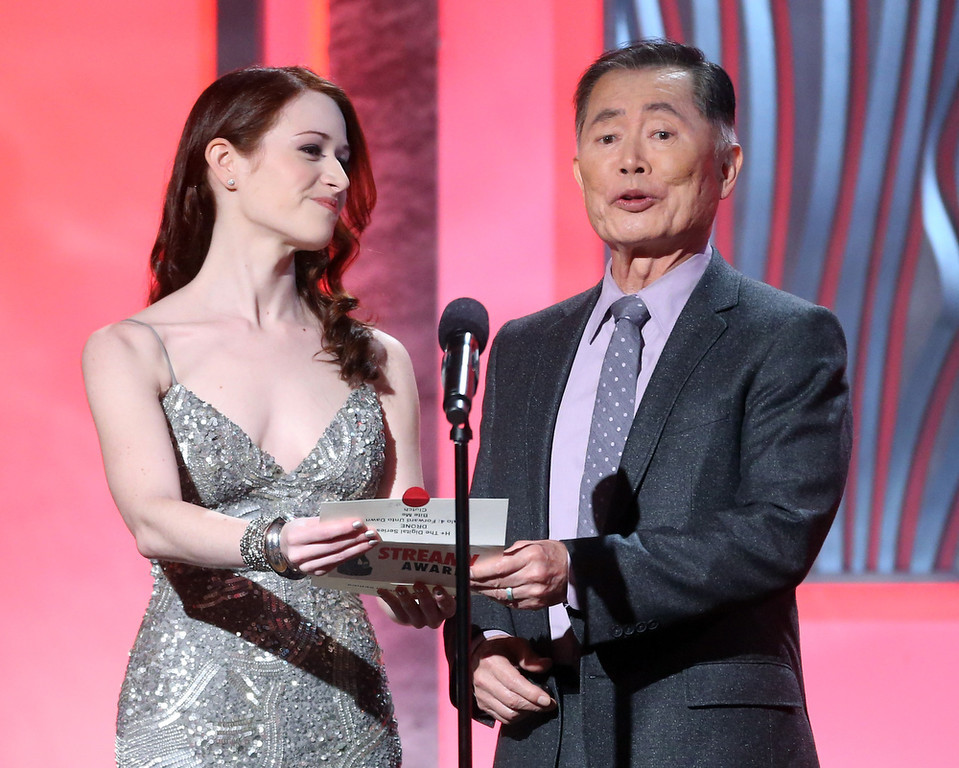 . Presenters Ashley Clements (L) and George Takei speak onstage at the 3rd Annual Streamy Awards at Hollywood Palladium on February 17, 2013 in Hollywood, California.  (Photo by Frederick M. Brown/Getty Images)