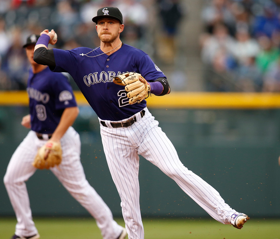 . Colorado Rockies shortstop Trevor Story throws to first base to put out Los Angeles Dodgers\' Howie Kendrick to end the top of the first inning of a baseball game Saturday, April 23, 2016, in Denver. (AP Photo/David Zalubowski)