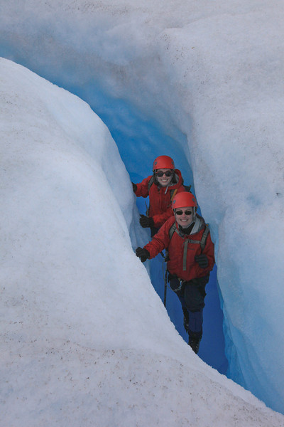 Stephanie & Tracy hiking through a crevice in the glacier