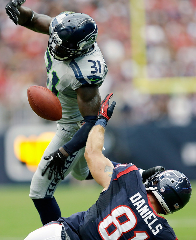 . Seattle Seahawks\' Kam Chancellor (31) breaks up a pass intended for Houston Texans\' Owen Daniels (81) during the first quarter an NFL football game on Sunday, Sept. 29, 2013, in Houston. Seahawks\' Earl Thomas made an interception off the tipped ball. (AP Photo/David J. Phillip)