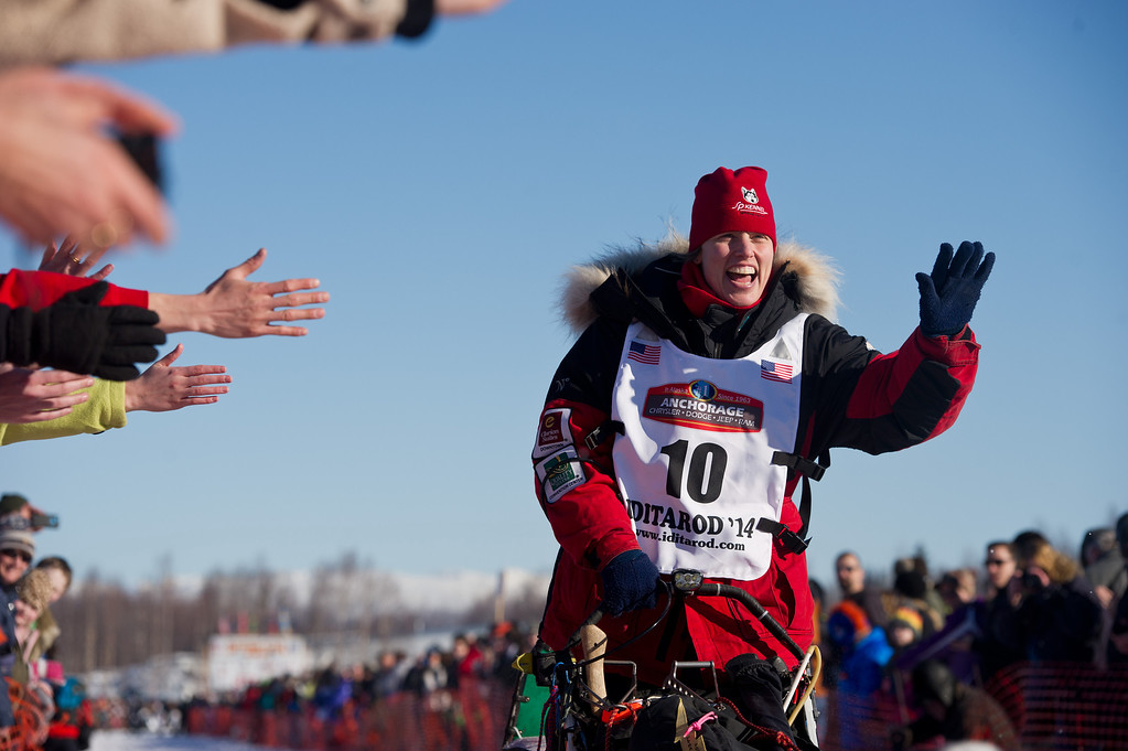. Aliy Zirkle waves to fans at the start of the Iditarod Trail Sled Dog Race on Sunday, March 2, 2014, in Willow, Alaska. (AP Photo/Anchorage Daily News, Marc Lester)
