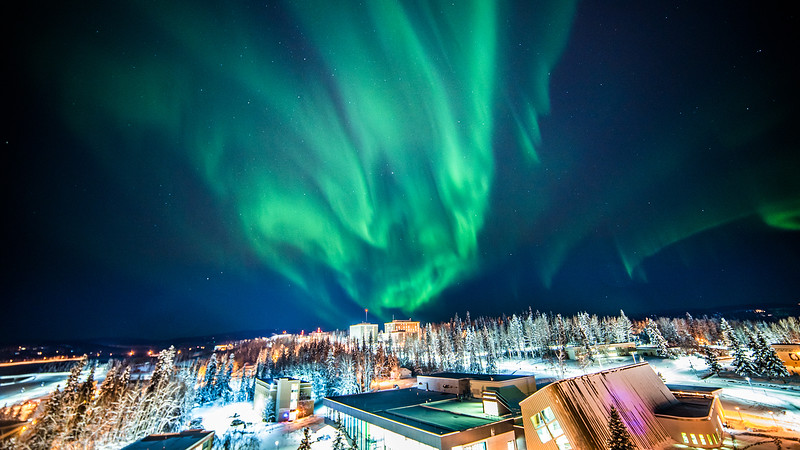 The northern lights dance over the top of campus on Nov. 20, 2017. Photo taken from the roof of Gruening. UAF photo by Zayn Roohi.