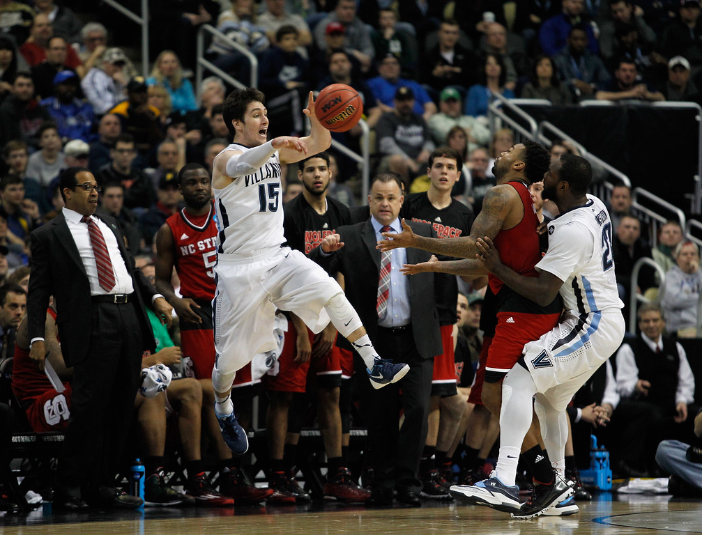 . Ryan Arcidiacono #15 of the Villanova Wildcats passes the ball against the North Carolina State Wolfpack in the second half during the third round of the 2015 NCAA Men\'s Basketball Tournament at Consol Energy Center on March 21, 2015 in Pittsburgh, Pennsylvania.  (Photo by Justin K. Aller/Getty Images)