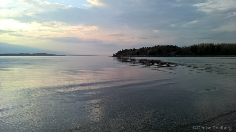 setting sun colors the water, looking at Bar Island in Bar Harbor