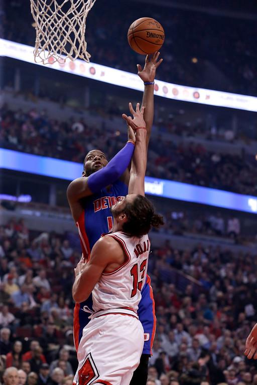 . Detroit Pistons forward Greg Monroe (10) shoots over Chicago Bulls center Joakim Noah (13) during the first half of an NBA basketball game Monday, Nov. 10, 2014, in Chicago. (AP Photo/Charles Rex Arbogast)