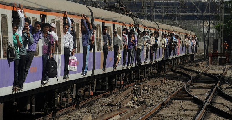 . In this photograph taken on March 14, 2012 passengers travel on a crowded train in Mumbai.   India\'s railway minister announced January 9, 2013 that the government would hike passenger fares this month for the first time in a decade to fund improvements in safety on the overburdened rail system. PUNIT PARANJPE/AFP/Getty Images