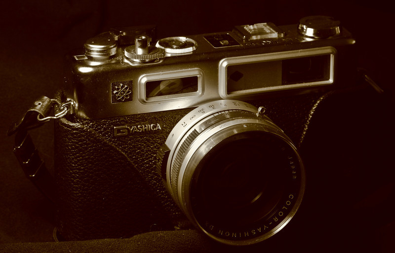 This is my dad's old Yashica SLR.  He probably bought this in mid to late '70s.  When I started my photography class in college, he gave me this to use, but it was just too old compared to everyone else in the class who had brand new awesome cameras.  My parents then bought me a new Nikon SLR for my birthday.