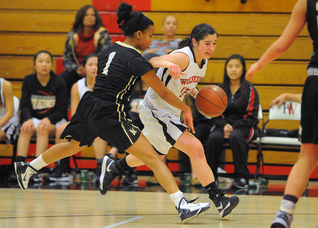 . STUDIO CITY - 02/16/13 - (Photo: Scott Varley, Los Angeles Newspaper Group)  CIF Southern Section Division IV-AA second-round girls basketball playoff game. Bishop Montgomery vs Harvard-Westlake. Bishop Montgomery won 57-42. H-W\'s Natalie Florescu drives the ball past Lisa Washington.