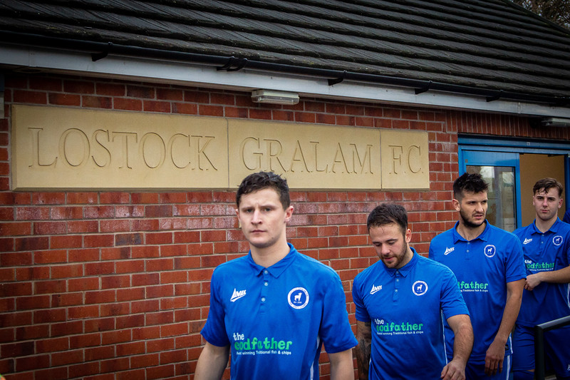 Lostock Gralam FC players emerge from the dressing room