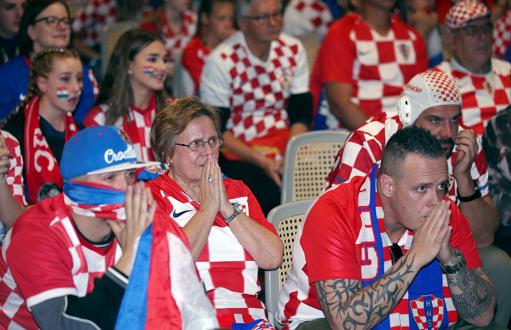 . Croatia fans at the King Tom Club in Sydney, Australia, watch the final moments of the soccer World Cup final between France and Croatia, Monday, July 16, 2018. (AP Photo/Rick Rycroft)