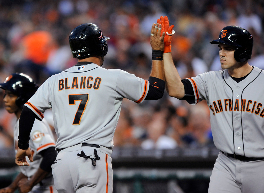 . San Francisco Giants� Gregor Blanco, left, is congratulated by Adam Duvall after Blanco scored against the Detroit Tigers in the second inning of a baseball game Friday, Sept. 5, 2014, in Detroit. (AP Photo/Jose Juarez)