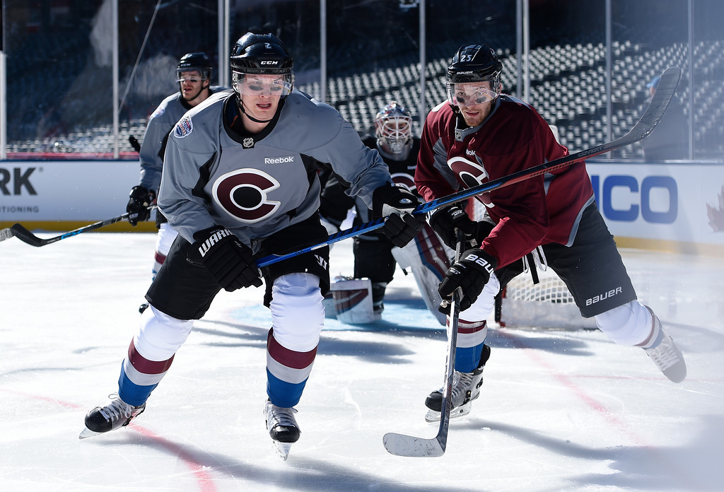 . Colorado Avalanche defenseman Nick Holden (2) and Colorado Avalanche center Mikhail Grigorenko (25) chase down the puck along the boards during practice February 26, 2016 at Coors Field. (Photo By John Leyba/The Denver Post)