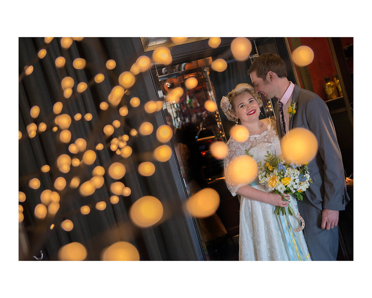 Wedding Photography of Blair & Adam, Glasgow, Photograph is of the Bride & Groom standing and surrounded by 'Fireflies""