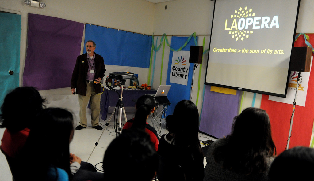 . Ron Streicher of the Los Angeles Opera Community Educational program speaks during a Los Angeles Opera slide show presentation on the opera �Cinderella,� composed by Gioachino Rossini at Norwood Library on Saturday, March 30, 2013 in El Monte, Calif.  (Keith Birmingham Pasadena Star-News)