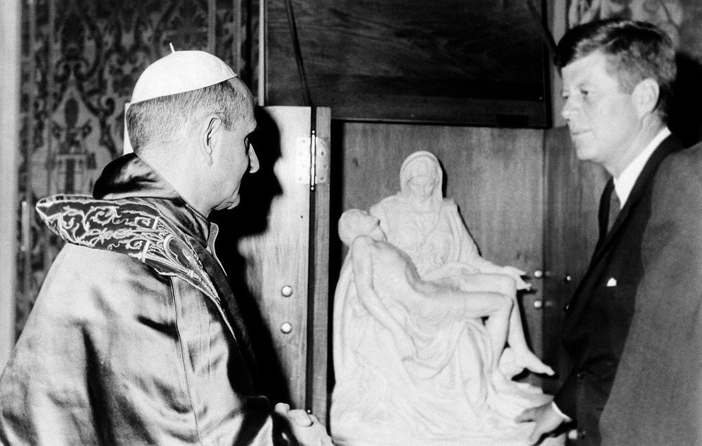 ". Pope Paul VI and President John F. Kennedy stand near model of the ""Pieta\"" by Michelangelo during audience on July 2, 1963. The pontiff presented President Kennedy with the model during the historic 40 minute meeting. (AP Photo)"