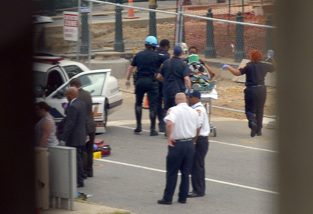 """. Capitol Hill police and medics take a shooting victim away on a stretcher at the site of a shooting October 3, 2013 on Capitol Hill in Washington, DC. The US Capitol was placed on security lockdown Thursday after shots were fired outside the complex, senators said. \""""Shots fired outside the Capitol. We are in temporary lock down,\"""" Senator Claire McCaskill said on Twitter. Police were seen running within the Capitol building and outside as vehicles swarmed to the scene. AFP PHOTO / Mandel  NGAN/AFP/Getty Images"""