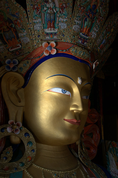 Close up of Maitreya Buddha statue at Thiksey Monastery in Ladakh, India.