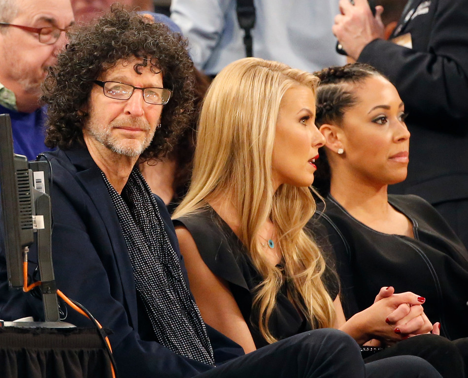 . Radio personality Howard Stern, left, and his wife Beth Ostrovsky sit in the front row during an NBA basketball game between the New York Knicks and the Cleveland Cavaliers at Madison Square Garden in New York, Wednesday, Dec. 7, 2016. (AP Photo/Kathy Willens)