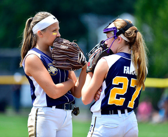 7/25/2019 Mike Orazzi | Staff Connecticut's Talia Salanto (4) and Avery Falco (27) during the Eastern Regional Softball Tournament at Breen Field in Bristol on Thursday.