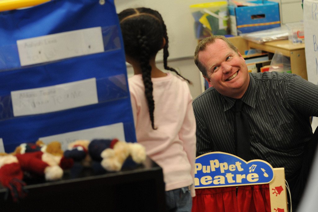 . Hamline Elementary principal, Craig Anderson, right, talks with a pre-kindergarten student during a free choice time. (Pioneer Press: Jean Pieri)