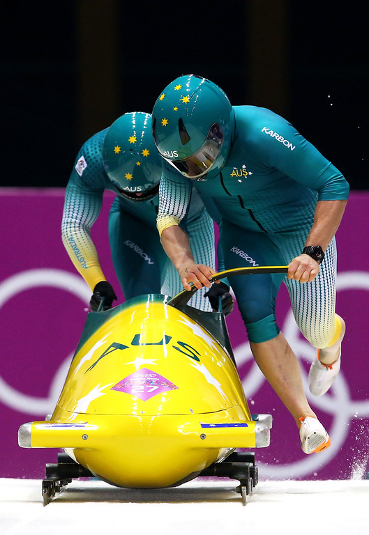 . Pilot Heath Spence and Duncan Harvey of Australia team 1 make a run during the Men\'s Two-Man Bobsleigh heats on Day 9 of the Sochi 2014 Winter Olympics at Sliding Center Sanki on February 16, 2014 in Sochi, Russia.  (Photo by Alex Livesey/Getty Images)
