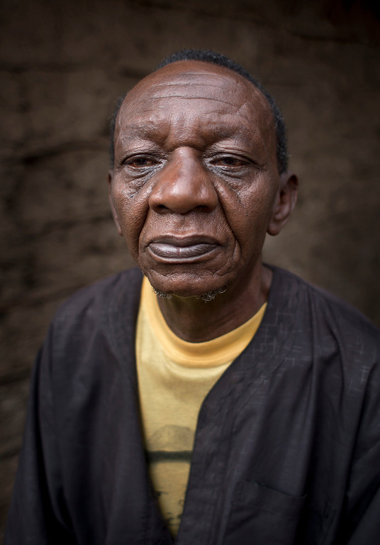 """. Juma Abdalla Athanas, 65, stands outside his home in the Kibera slum of Nairobi, Kenya on Friday, Sept. 6, 2013. When asked: As you grow older, what are you most afraid of and what is the biggest problem facing the elderly in your country? Abdalla Athanas said, \""""We are waiting for the title deeds to our land and the main problem is how are we going to leave it to our sons and grandsons? We have had many problems, every government is lying to us and each government comes and goes and we are still waiting.\"""" \""""My health is the problem, I don\'t have strength, the way I am getting old. There are different types of old people ñ those who have money can be taken to the old people\'s home, but for those who don\'t have money, we have nowhere to go.\"""" (AP Photo/Ben Curtis)"""