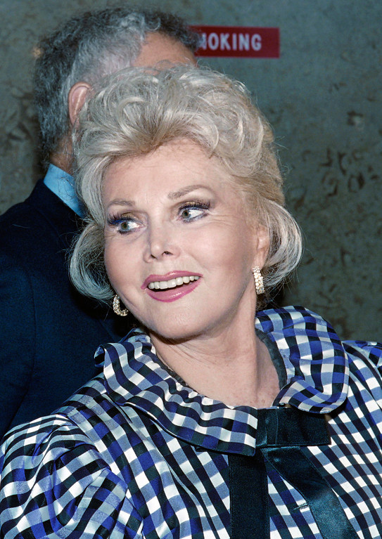 . This file photo taken on July 12, 1989 shows US actress Zsa Zsa Gabor smiling as she exits from Beverly Hills Municipal Court where she appeared in order to answer charges of battery against a police officer.       (HAL GARB/AFP/Getty Images)