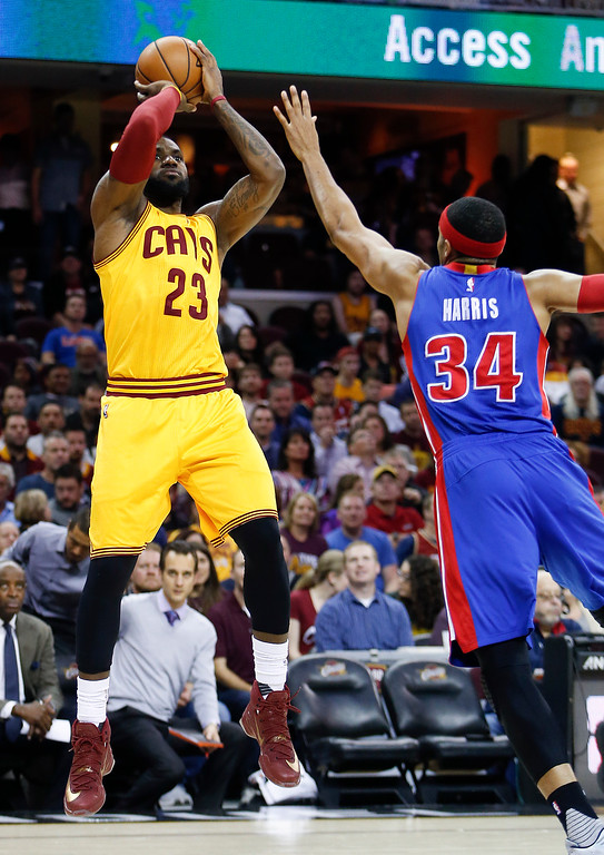 . Cleveland Cavaliers\' LeBron James (23) shoots over Detroit Pistons\' Tobias Harris (34) during the first half of an NBA basketball game Friday, Nov. 18, 2016, in Cleveland. (AP Photo/Ron Schwane)