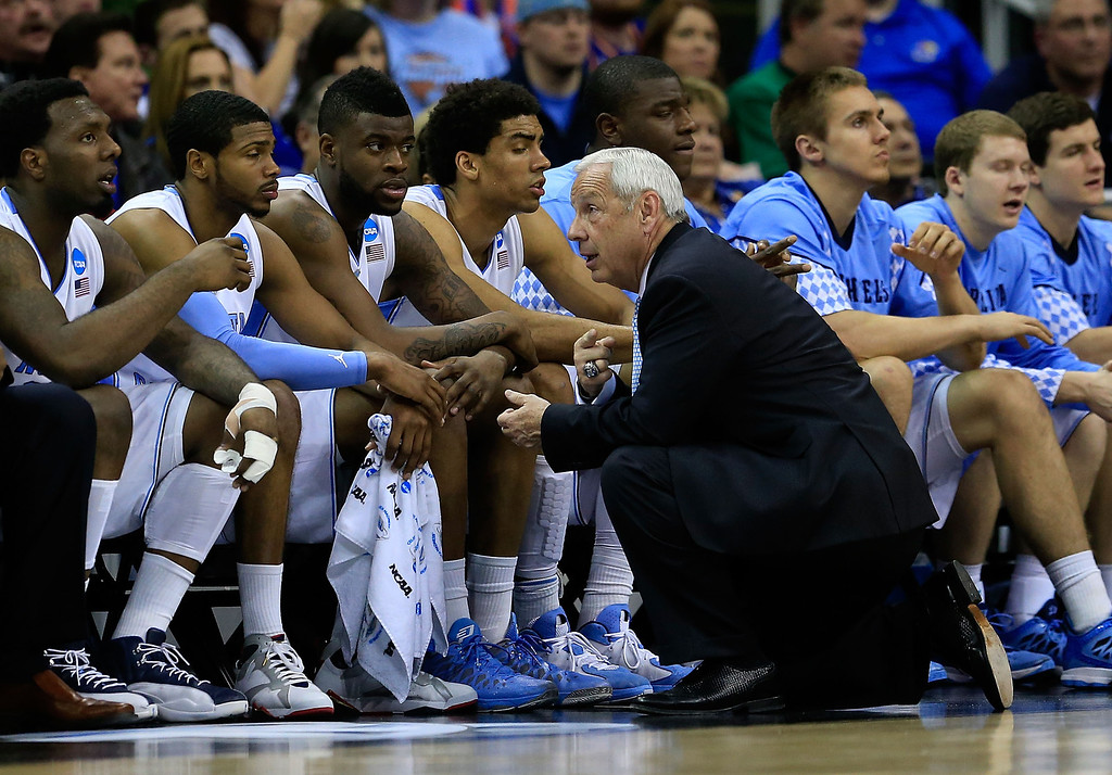 . KANSAS CITY, MO - MARCH 22:  Head coach Roy Williams of the North Carolina Tar Heels talks to players on the bench in the second half against the Villanova Wildcats during the second round of the 2013 NCAA Men\'s Basketball Tournament at the Sprint Center on March 22, 2013 in Kansas City, Missouri.  (Photo by Jamie Squire/Getty Images)