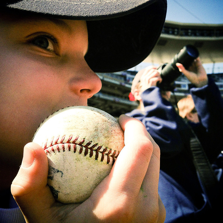 ". 10-year-old Mason McKnight of Inver Grove Heights waits patiently for an autograph from Joe Mauer prior to the first pitch. ""When the twins get outs it\'s, like, boring cause cause they have to switch innings.\"" (Pioneer Press: Ben Garvin)"