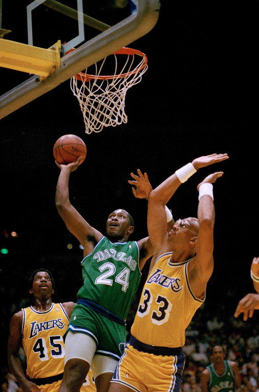 . Mark Aguirre of the Dallas Mavericks goes up against Los Angeles Lakers Kareem Abdul-Jabbar during first quarter of their NBA playoff game at the Forum in Inglewood, Calif., Monday, May 23, 1988. Left is Lakers A. C. Green (45). (AP Photo/Reed Saxon)