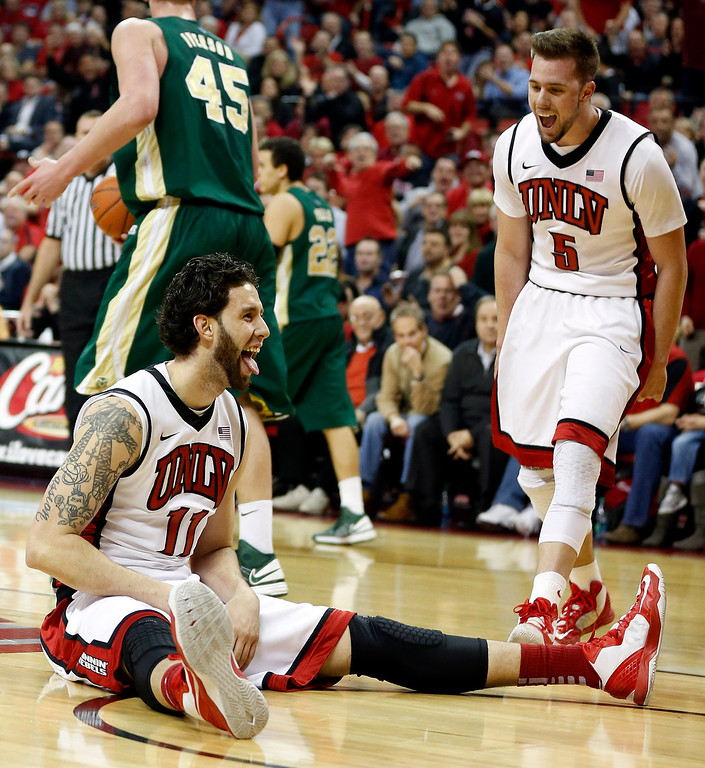 . UNLV\'s Carlos Lopez-Sosa, left, and Katin Reinhardt react to a call during the first half of an NCAA college basketball game against Colorado State on Wednesday, Feb. 20, 2013, in Las Vegas. (AP Photo/Isaac Brekken)