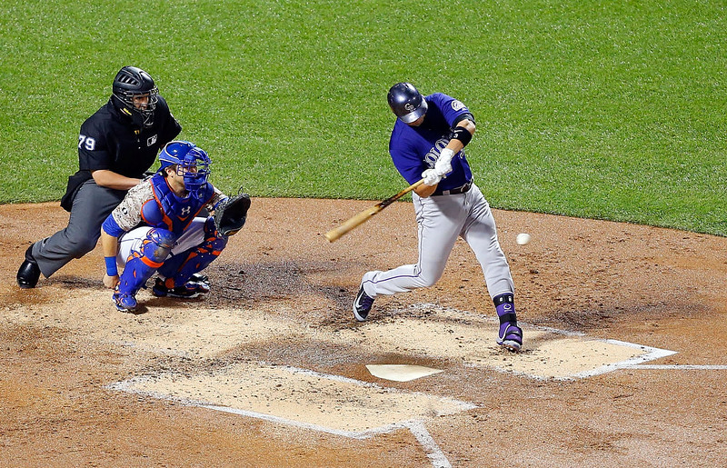 . Michael Cuddyer #3 of the Colorado Rockies connects on a second inning home run against the New York Mets at Citi Field on September 8, 2014 in the Flushing neighborhood of the Queens borough of New York City.  (Photo by Jim McIsaac/Getty Images)