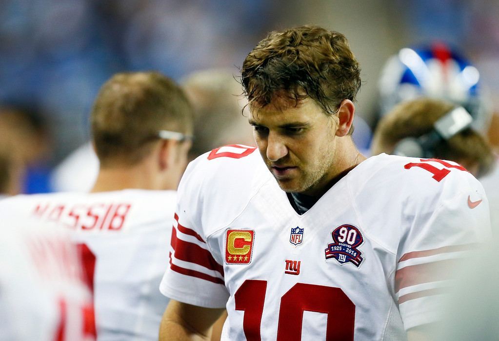 . New York Giants quarterback Eli Manning is seen on the sidelines during the second quarter of an NFL football game against the Detroit Lions in Detroit, Monday, Sept. 8, 2014. (AP Photo/Paul Sancya)