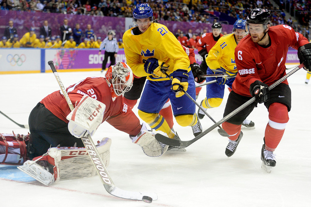 . Switzerland goalie Reto Berra defends a shot by Sweden\'s Loui Eriksson as teammate Yannick Weber defends during the action at Bolshoy Arena. Sochi 2014 Winter Olympics on Friday, February 14, 2014. (Photo by AAron Ontiveroz/The Denver Post)