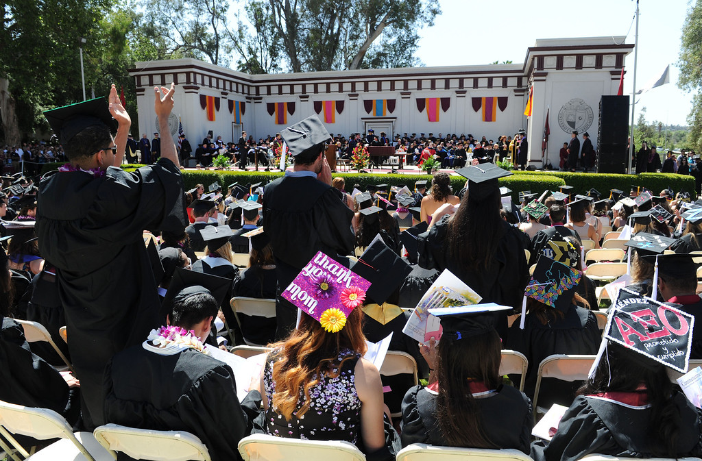 """. (John Valenzuela/Staff Photographer) University of Redlands students cheer for fellow graduates during the commencement ceremony for the University\'s 104th College of Arts & Sciences graduation, Saturday, April 20, 2013. University of Redlands alumni, Marilyn Magness Carroll, class of 1975, delivered the Commencement speech, \"""" If You Can Dream It, You can Do It\""""."""