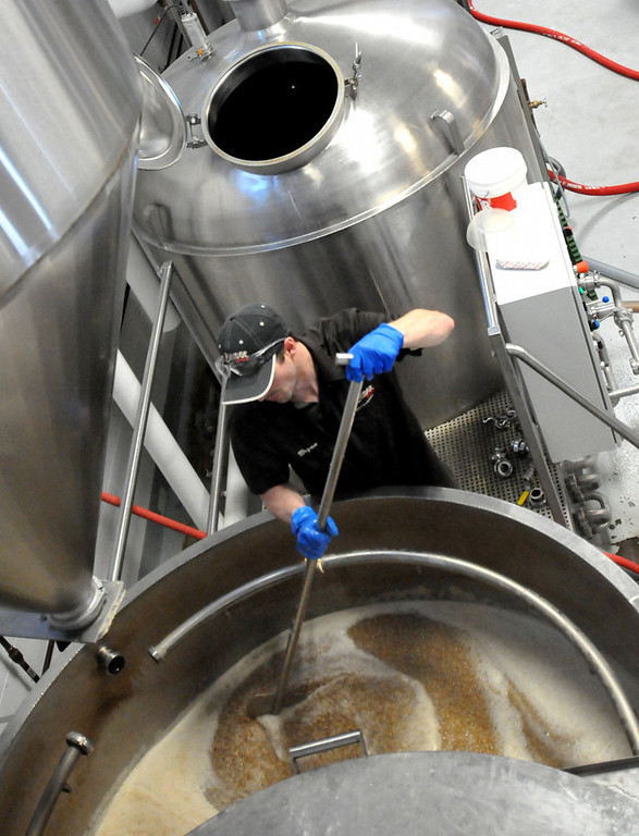 . Lift Bridge Brewery assistant brewer Bryan Trost stirs the mash for a batch of Oktoberfest beer that will be ready at the end of August. (Pioneer Press: John Doman)