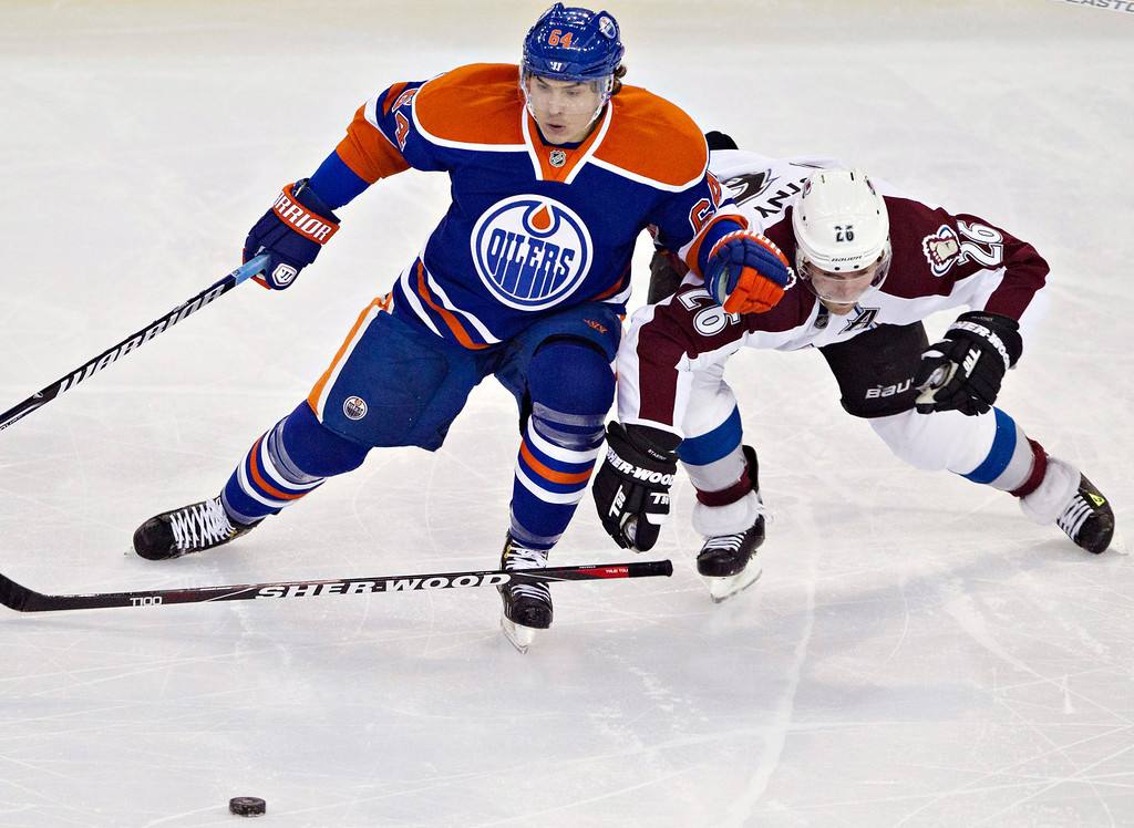 . Edmonton Oilers\' Nail Yakupov, left, battles for the puck with Colorado Avalanche\'s Paul Stastnyduring the second period of their NHL hockey game, Monday, Jan. 28, 2013, in Edmonton, Alberta. (AP Photo/The Canadian Press, Jason Franson)